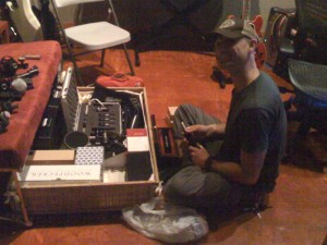 My producer Eric Peterson with his toy box, er, mic collection!